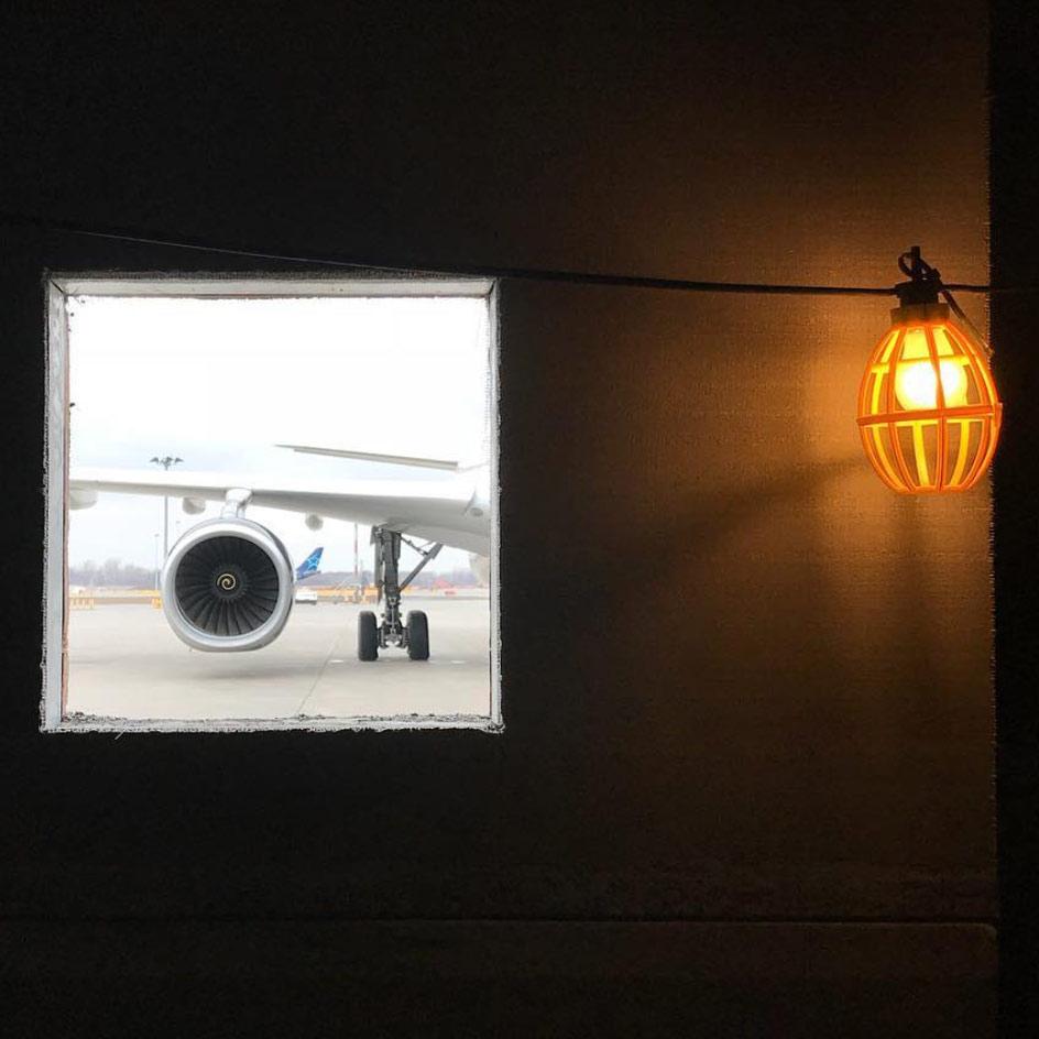 Plane on the wall by Umed Sadykov